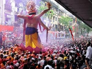 Devotees carry an idol of Lord Ganesh to Girgaon Chawpatty for immersion