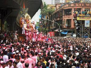 Devotees carry the Lalbaugcha Raja idol to Girgaon Chawpatty
