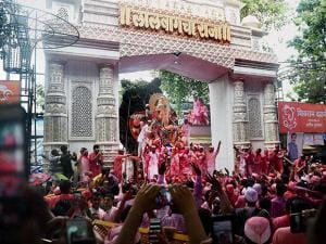 Devotees carry the Lalbaugcha Raja idol to Girgaon Chawpatty for immersion on the last day  festival