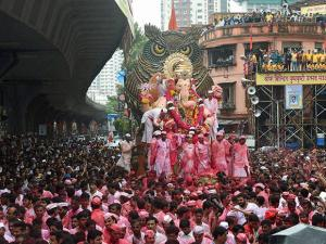Devotees carry the Lalbaugcha Raja idol to Girgaon Chawpatty for immersion on the last day of Ganesh festival