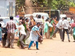 Agitated garment workers pelting stones during the protest rally  over EPF withdrawal norm, in Bengaluru.