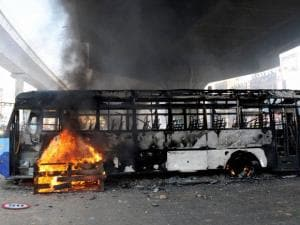 Charred buses which were torched by garment_workers during a protest rally over EPF withdrawal norm, in Bengaluru