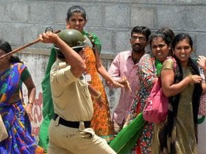 Police charge the garment workers who were protesting over EPF withdrawal norm, in Bengaluru