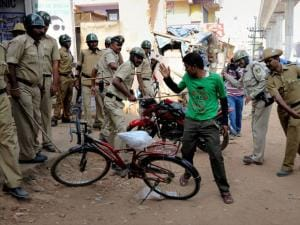 Police in action against garment workers who were protesting over EPF withdrawal norm, in Bengaluru