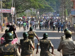Police in action against garment workers who were protesting over EPF_withdrawal norm, in Bengaluru