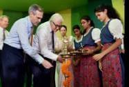 German Foreign Minister Frank-Walter Steinmeier and German Ambassador to India Michael Steiner lighting the lamp at the Masjid Moth Kendriya Vidyalaya
