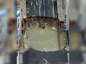A massive shinkhole is created in the middle of the business district in Fukuoka