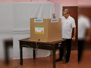 Manohar Parrikar casting his vote at a polling booth in Goa