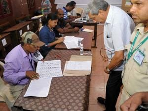 Manohar Parrikar finding his name in the voter list at a polling booth in Goa