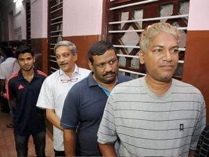 Manohar Parrikar in a queue outside a polling booth to cast his vote in Goa