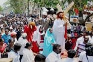 Christians takes part in a procession on the occasion of Good Friday