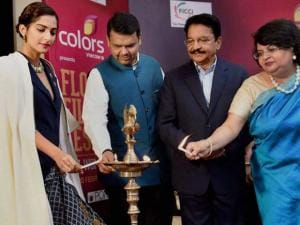 Sonam Kapoor C Vidyasagar Rao, Devendra Fadnavis and Archana Garodia lighting lamps during the inauguration of the 'FLO Film Festival' in Mumbai