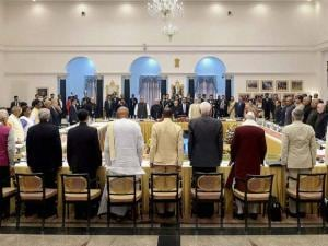 President Pranab Mukherjee with Vice President, M. Hamid Ansari, Prime Minister Narendra Modi and other dignitaries stand for national anthem during the Governors Conference at Rashtrapati Bhavan