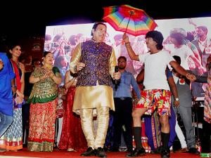Govinda dances with artists at a Garba function on the fourth day of the Navratri festival in Ahmedabad