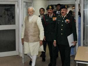 Narendra Modi with Army chief Gen Dalbir Singh walks to a ward of Army's Research & Referral Hospital to see Lance Naik Hanumanthappa who is critical and on a ventilator