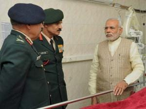 Prime Minister Narendra Modi with Army chief Gen Dalbir Singh and head of the medical team in the ward at a ward of Army's Research & Referral Hospital where Lance Naik Hanumanthappa who is critical