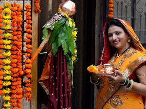 A woman, in traditional Marathi attire, prepares to celebrate the Maharashtrian new year Gudi Padwa