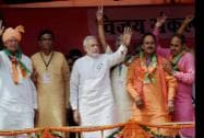 Prime Minister Narendra Modi waves at an election rally