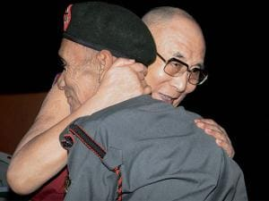 Tibetan spiritual leader Dalai Lama with Naren Chandra Das, a retired havildar of 5 Assam Rifles