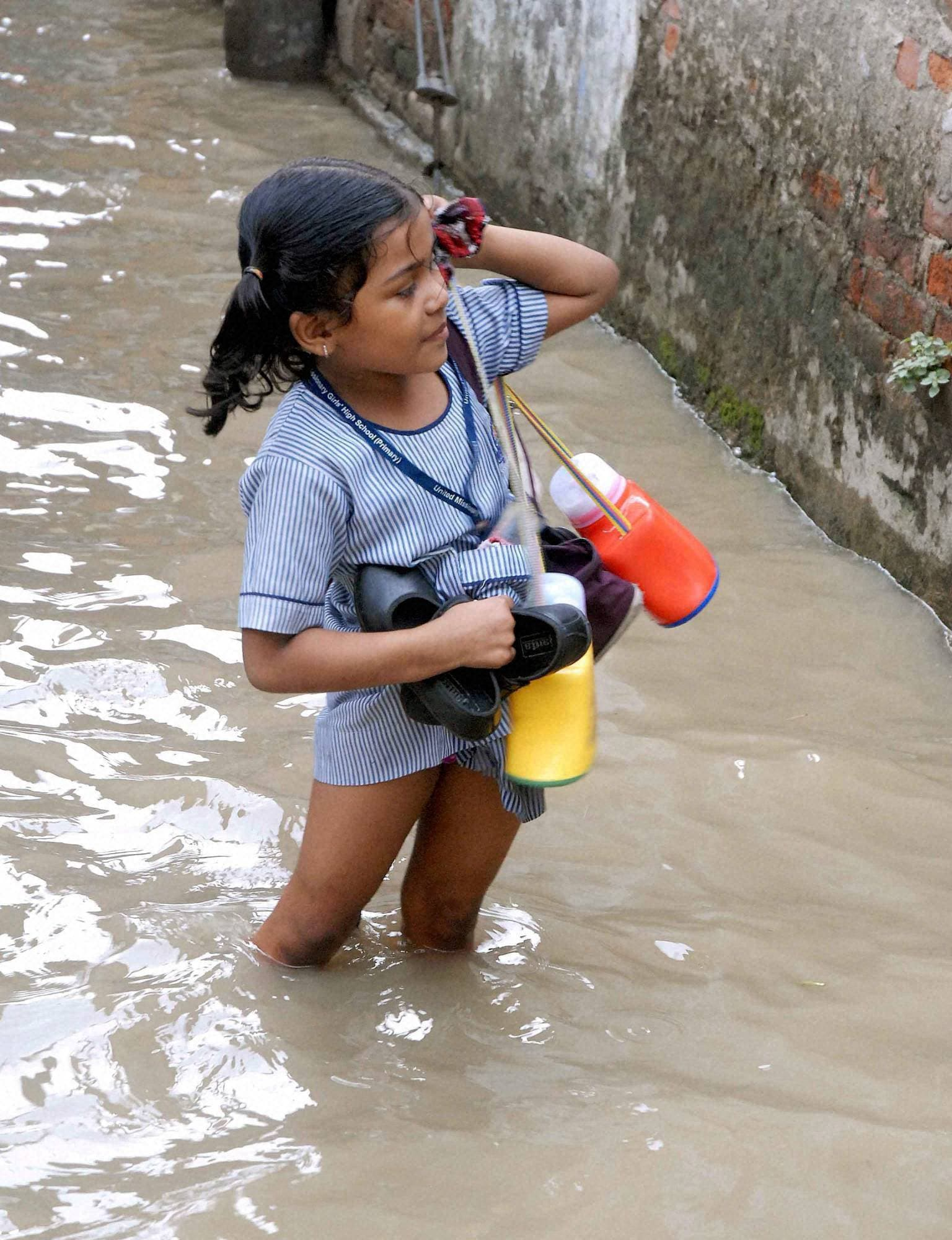 little, school girl, wades, road, flooded, river, Ganga, Kalighat Kali, temple, Kolkata