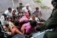 Air Force personnel rescue stranded people after heavy rains caused floods in Amreli