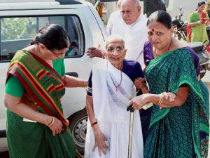 Prime Minister Narendra Modi's mother Heeraben Modi  visits a bank to exchange old currency