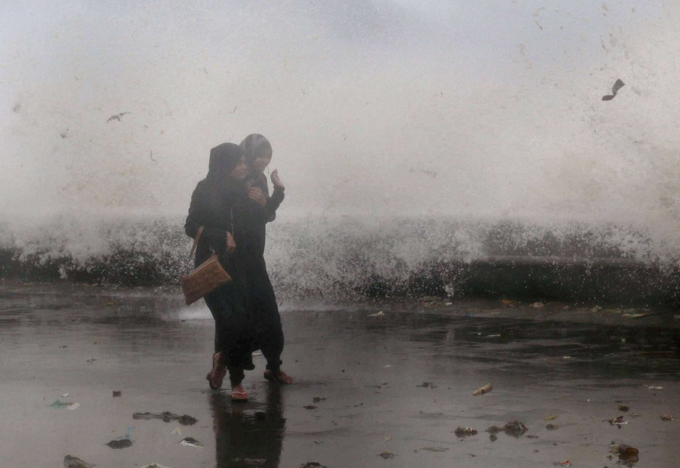 Girls, enjoying, high tide, Marine Drive, Mumbai