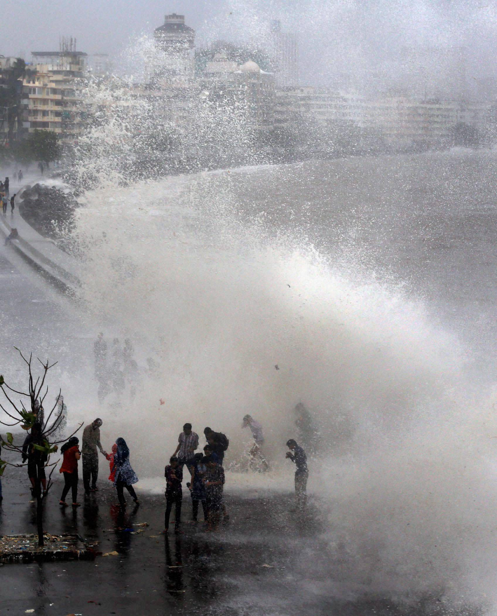 People, enjoying, high tide, Marine Drive, Mumbai