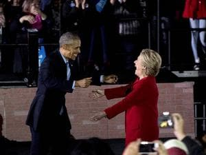 President Barack Obama greets Democratic presidential candidate Hillary Clinton