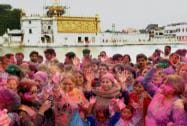 Devotees celebrating Holi at Durgiana Temple in