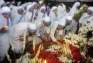 Nuns of Missionaries of Charity pay homage as they bury Sister Nirmala Joshi successor of Mother Teresa