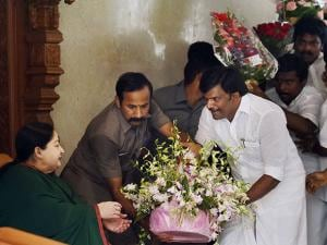 Tamil Nadu Chief Minister and AIADMK Supremo J Jayalalithaa is greeted by party cadres after the party's win in the state Assembly polls