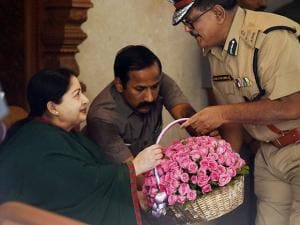 Tamil Nadu Chief Minister and AIADMK Supremo J Jayalalithaa receiving a floral bouquet from City Police Commissioner Ashutosh Shukla  after her party's win in the state Assembly polls