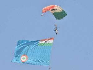 An IAF paratrooper performs during a show