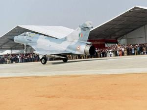 fighter jet touches down  during the grand opening of Agra-Lucknow expressway