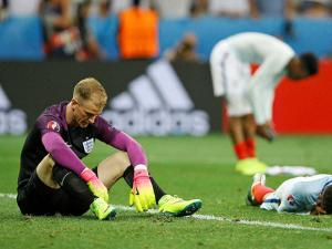 England goalkeeper Joe Hart, left, and his teammates react  at the end of the Euro 2016
