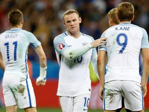 England's Wayne Rooney comforts is teammates at the end of the Euro 2016