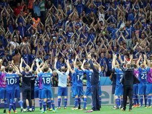 Iceland players celebrate with their supporters at the end of the Euro 2016