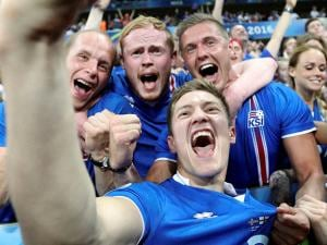Iceland's Haukur Heidar Hauksson takes a selfie with supporters at the end of the Euro 2016
