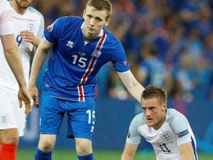Iceland's Jon Dadi Bodvarsson pats England's Jamie Vardy on the back at the end of the Euro 2016