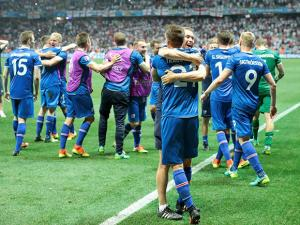 Iceland's players celebrate at the end of the Euro 2016 round