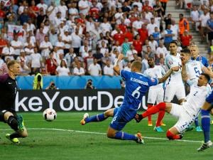 Iceland's Ragnar Sigurdsson, scores his side's first goal past England goalkeeper Joe Hart at Euro 2016