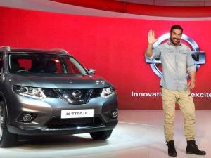 Newly-appointed brand ambassador of Nissan India, actor John Abraham at the company's gallery at Auto Expo 2016
