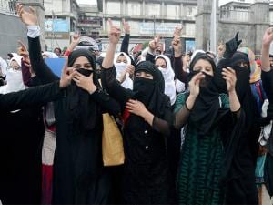 College girls shout slogans at a protest against the recent police action on students