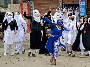 Girl students pelt stones at security personnel during clashes in the vicinity of Lal Chowk