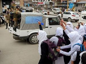 Girl students shout slogans during clashes with security personnel