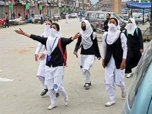 Girl students shout slogans during clashes with security personnel in the vicinity of Lal Chowk