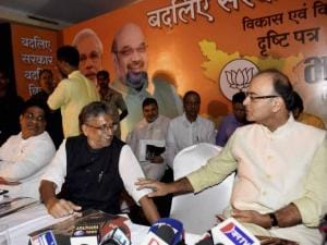 Union Finance Minister Arun Jaitley interacts with senior BJP leader Sushil Kumar Modi