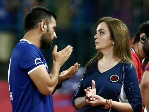 Indian cricketer MS Dhoni and ISL chairperson Nita Ambani