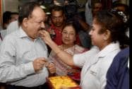 Union Minister for Health and Family Welfare Harsh Vardhan is offered sweet by a nurse